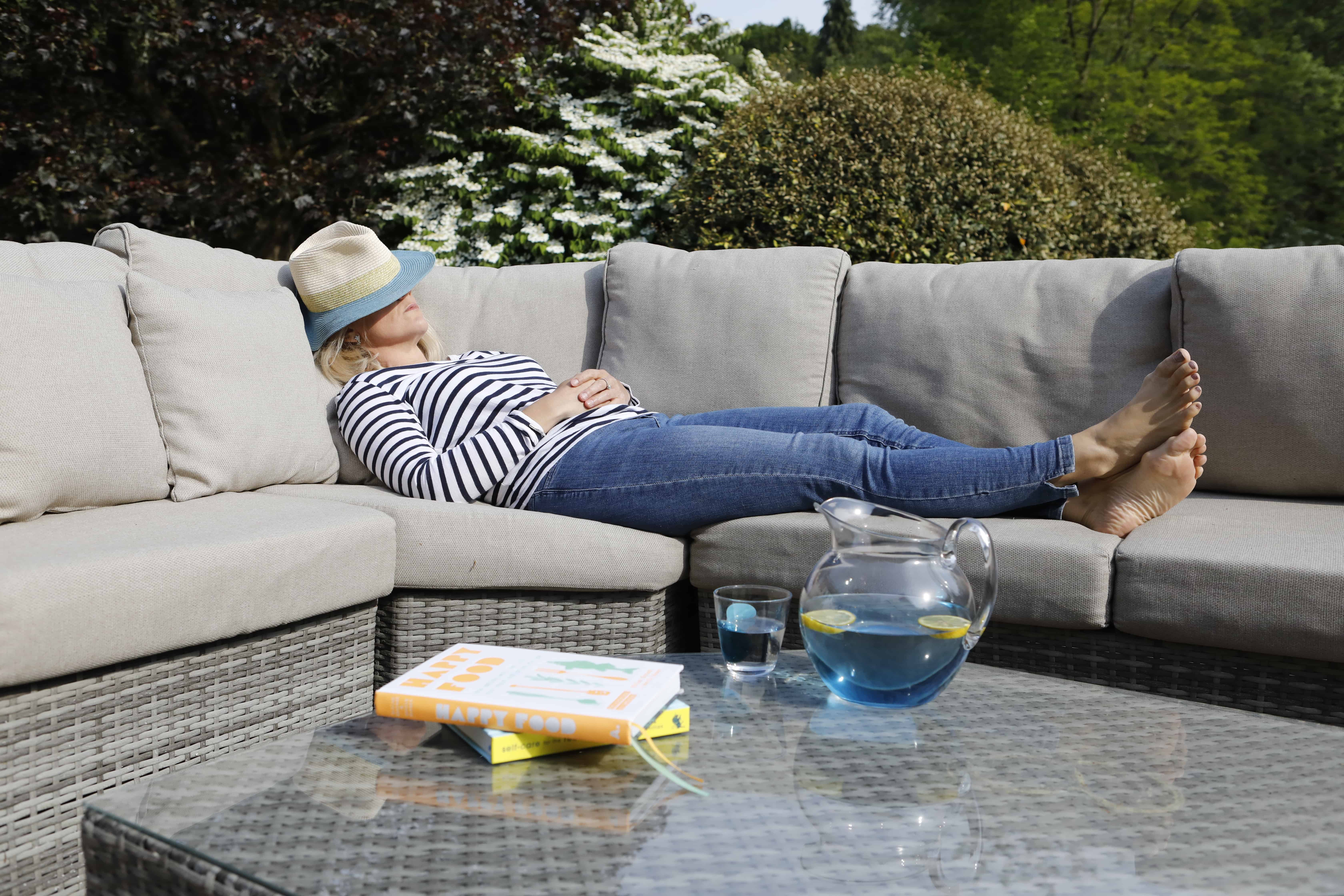 Kate asleep with hat on face 2 with water jug